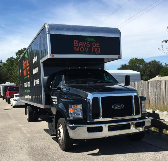 Black-Ford-F650-with-26ft-Mover-Body